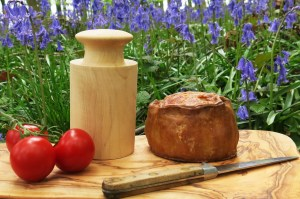 An authentic Melton Mowbray pork pie in the bluebell woods, posing with my new dolly