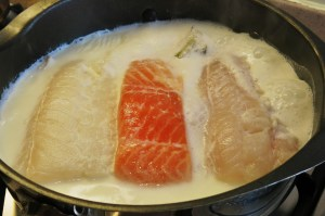 Cod, salmon and haddock poaching in milk