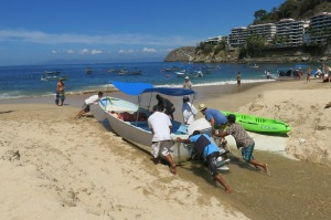 Community boat launching in Mismaloya