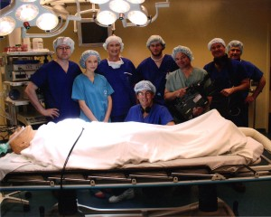 Chairman Tony Fell (3rd from L) in the wrap photo (the patient is a practice dummy)