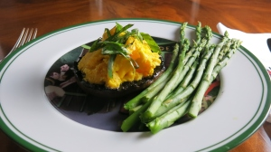Grilled Portobello mushrooms served with steamed asparagus spears