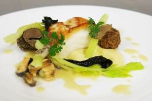 Baked Whitby cod with rope cultured mussels and champagne sauce, artichoke purèe and fresh truffle arancini with celery
