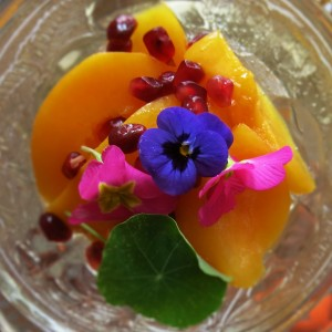 Edible flowers, peaches and pomegranate seeds from three farmers' markets make a delicious dessert