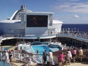 Watch movies poolside while at sea