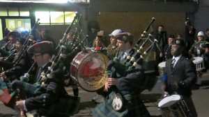 The Warterloo Bonfire Society Pipe and Drum Band marches past