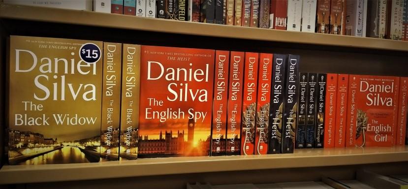 Daniel Silva books fill a shelf at a local bookstore