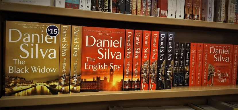 Daniel Silva books fill a shelf at a local bookstore