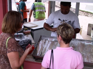 Buying fresh fish at the port's market